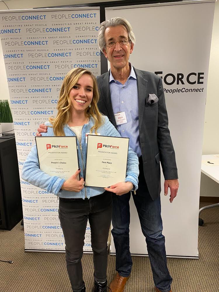 Farren holds her Best Pitch and People's Choice awards while standing with event producer and PeopleConnect CEO Max Shapiro.