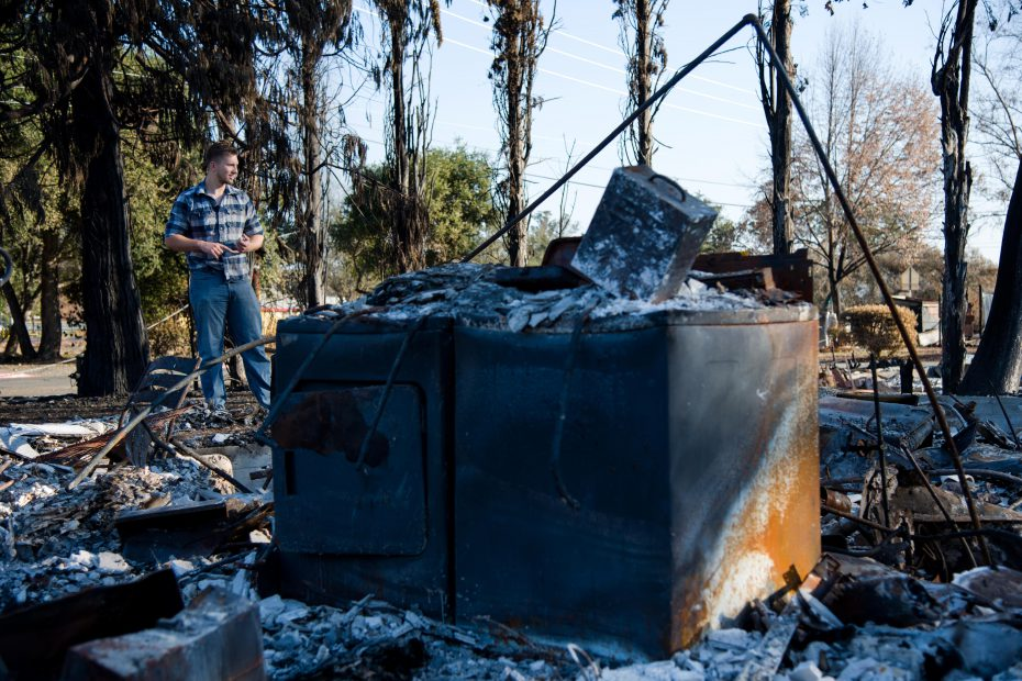 Someone surveys the remains of their family's home in Santa Rosa, California following the 2017 Tubbs Fire. More than 4,600 homes were destroyed in the fire.