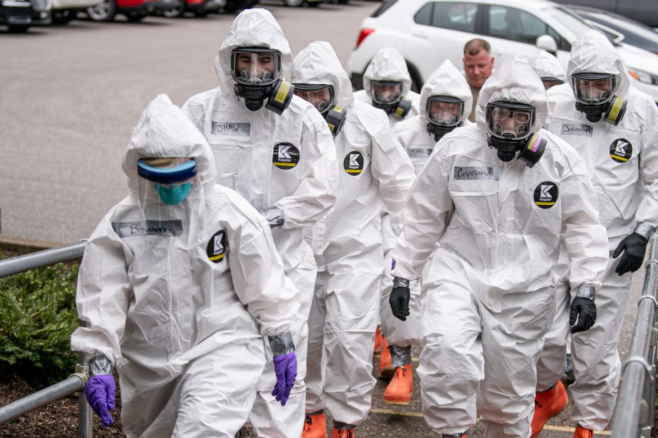 Members of the West Virginia National Guard's Task Force Chemical, Biological, Radiological and Nuclear (CBRN) Response Enterprise (CRE) (TF-CRE) assist staff, medical personnel, and first responders of an Eastbrook Center nursing home with COVID-19 testing April 6, 2020, in Charleston, West Virginia, after a resident tested positive for the pandemic virus.