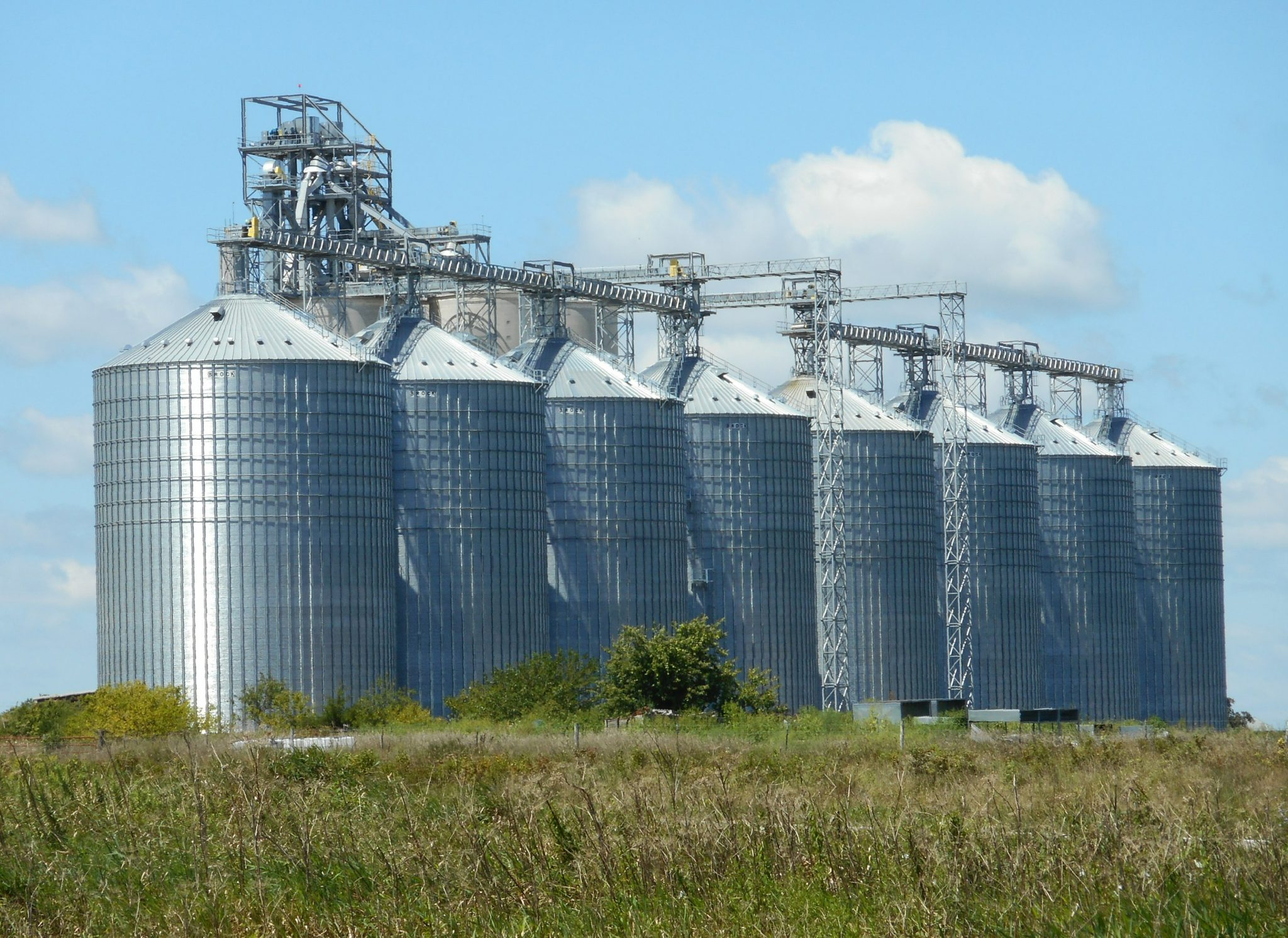Grain silos on a field.