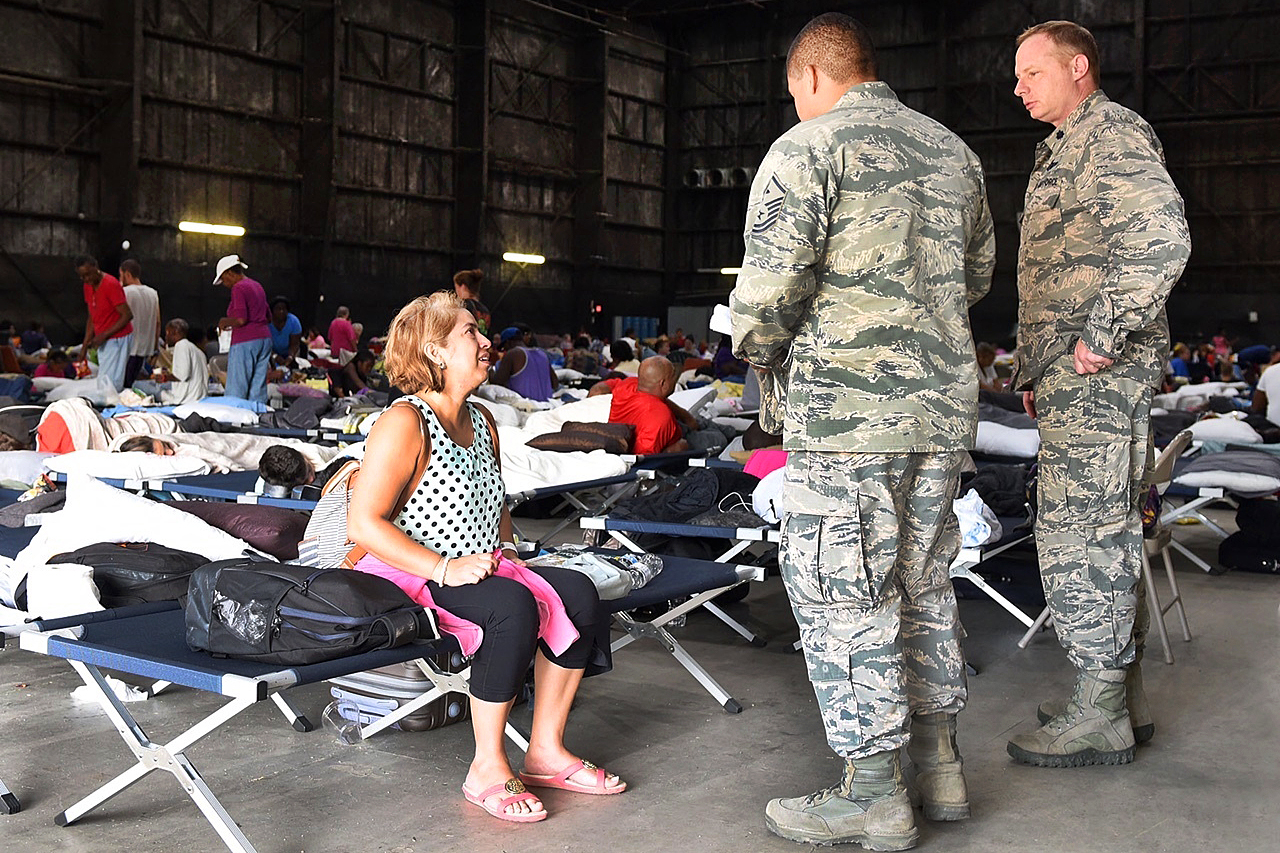 Residents stay at a makeshift evacuation shelter.