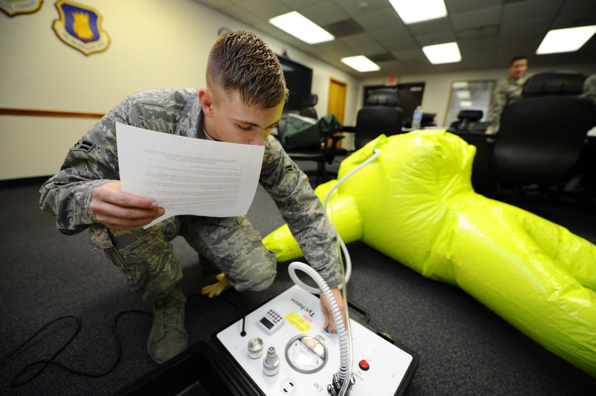 A member of the 22nd Civil Engineer Squadron checks equipment as part of their emergency management preparatory work.