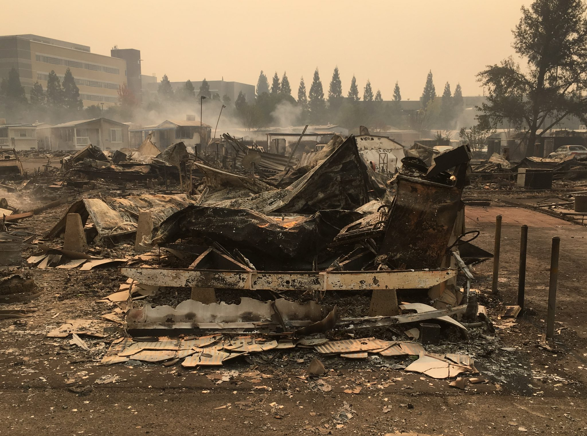 The remains of a mobile home in Santa Rosa smolder during the Tubbs Fire.