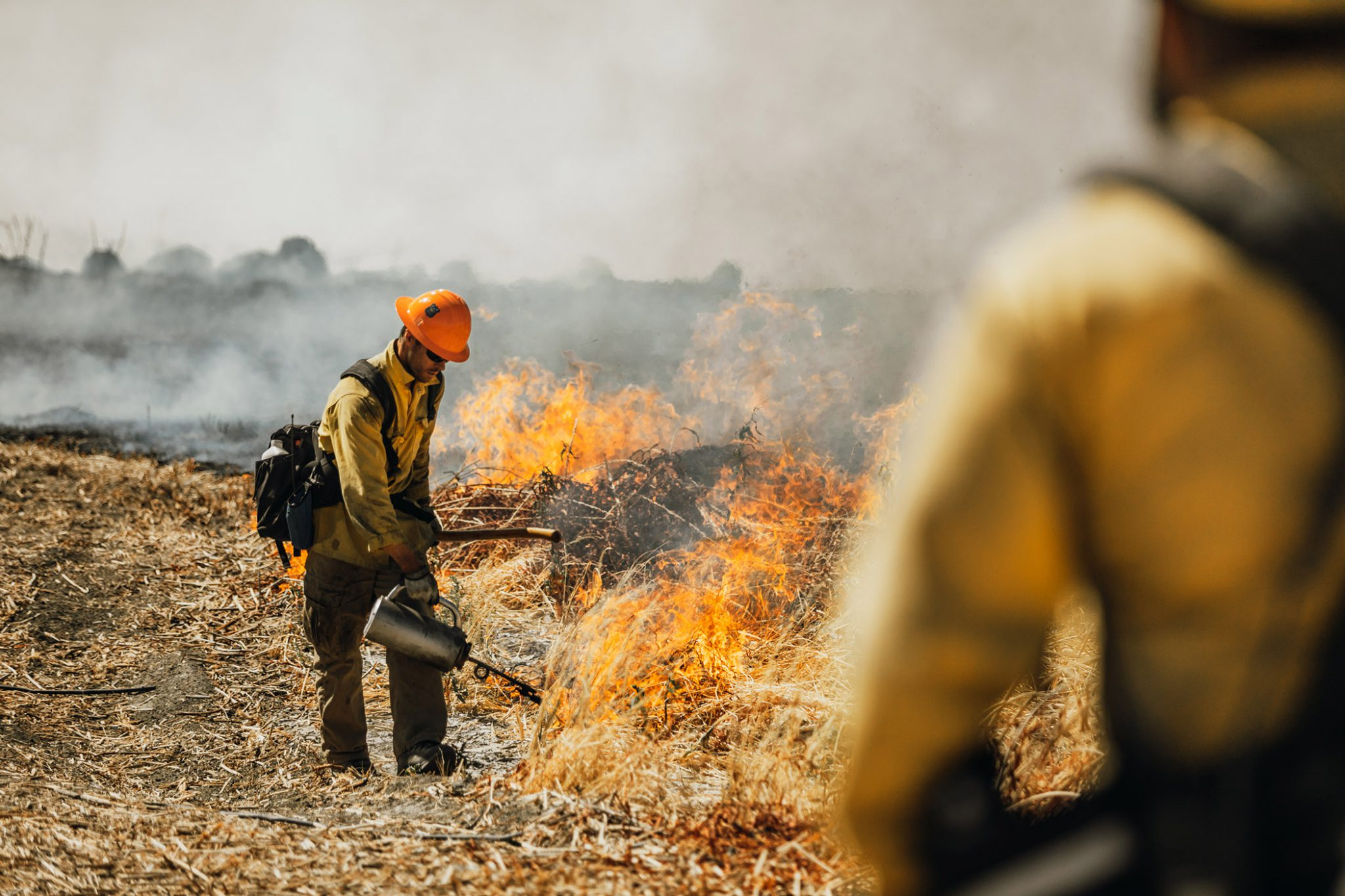 Crews conduct controlled burns at the Edwards Air Force Base in California.