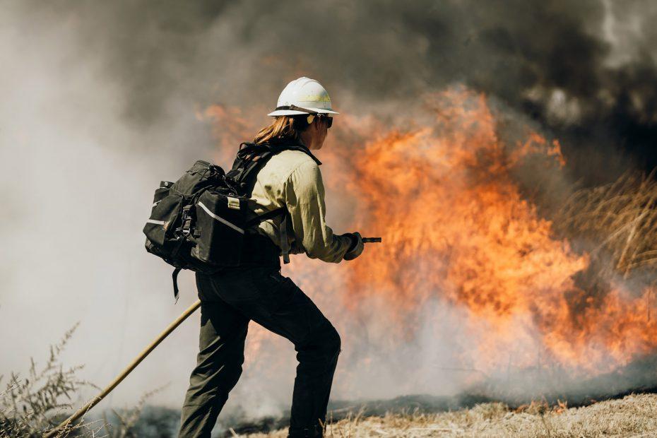 A crew member monitors a controlled burn.