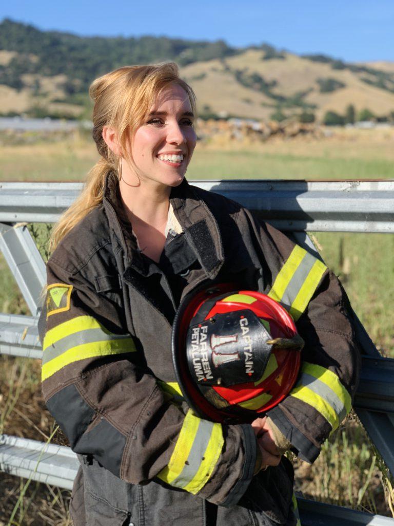 Perimeter CEO Bailey Farren wears a firefighting uniform.