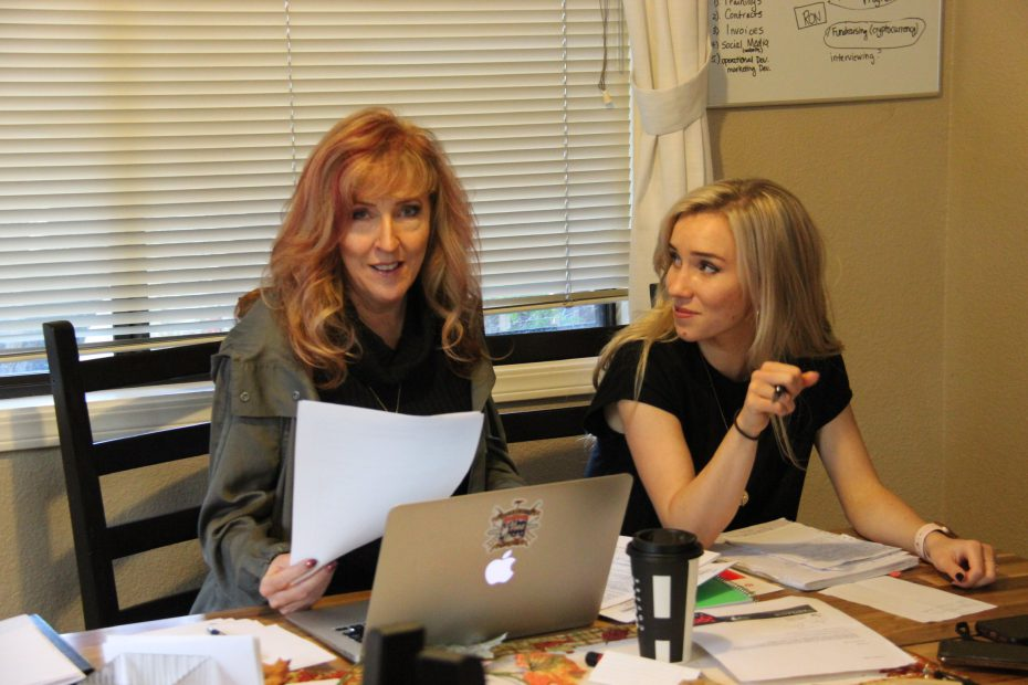Perimeter CEO Bailey Farren works at a desk with her mother, Susan Farren, founder of First Responder Resiliency, Inc.